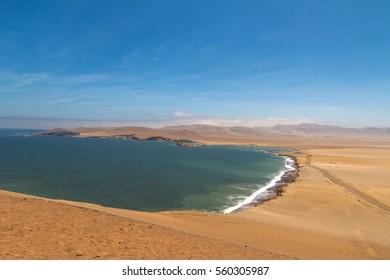 Peru, Paracas, National Reserve. Sandy oceanic shore.