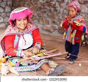 Peru-December, 2017-Mother and son weaving