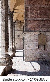Perugia, Italy - 06/01/2016: photograph of the exterior of San Lorenzo Cathedral in Perugia; cloumns with arches and shadows.