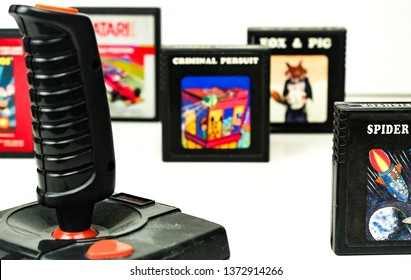 Perugia, Italy - 13 March, 2019: Atari Video Games Set: Joystick and a few cassettes (Spider Fighter, Fox & Pig, Criminal Persuit, Pole Position, Mario Bros)