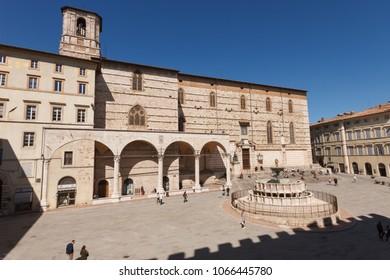 Perugia, Italy - April 7, 2018: San Lorenzo cathedral with the Loggia di Braccio and the Fontana Maggiore (fountain) in Piazza IV Novembre (square)