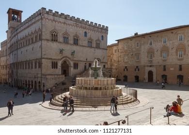Perugia, Italy - April 7, 2018: Palazzo dei Priori and the Fontana Maggiore (fountain) in Piazza IV Novembre (square)