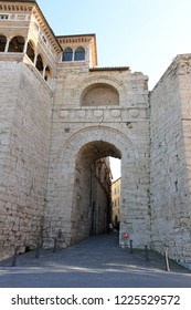 Perugia, Italy - April 7, 2018: The Etruscan Arch (or Arch of Augustus or Augustus Gate) is one of eight gates in the Etruscan wall of Perugia in Italy.
