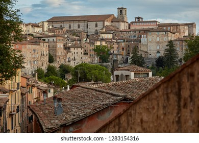 PERUGIA, ITALY - AUGUST 15, 2018: Cityscape with Perugia Cathedral dominated the city. Dedicated to Saint Lawrence, the cathedral was consecrated in 1587