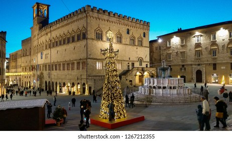 PERUGIA, ITALY - DECEMBER 25, 2018: Medieval main square of Perugia with christmas tree at twilight in Umbria