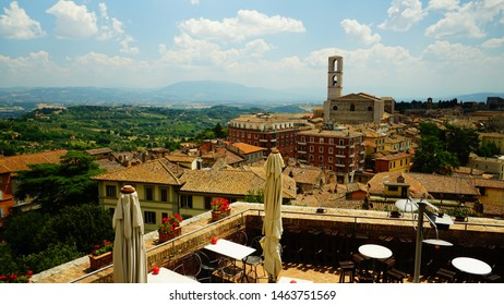 Perugia, Italy - July 21, 2018: View of the city of Perugia from the terrace of a building at the top with a balcony with flower pots