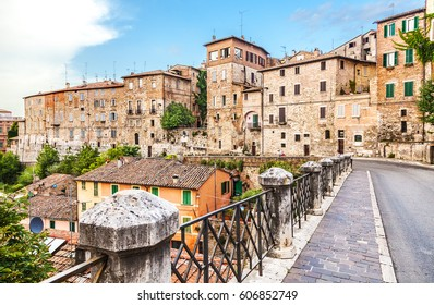 Perugia, Italy - July 5, 2015: Street with old stone houses in Perugia at sunset, Umbria, Italy