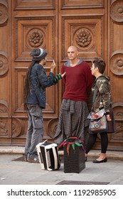 Perugia, Italy, May 13, 2013: Three people standing in front of an apartment door and talking in Perugia, Italy