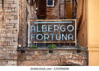 Perugia, Italy, May 13, 2013: Vintage neon sign mounted on top of an arched wall in Perugia, Italy