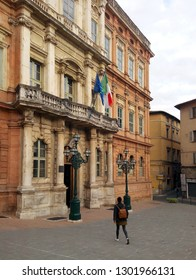 PERUGIA, ITALY - OCTOBER 16, 2018: A female student walks towards the entrance of the University for Foreigners of Perugia.