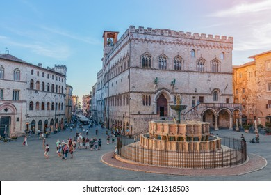 PERUGIA, ITALY - SEPTEMBER 11, 2018: View of the scenic main square (Piazza IV Novembre) and fountain (Fontana Maggiore) masterpiece of medieval architecture in Perugia, Umbria, Italy