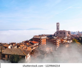 Perugia in a misty cloud and fog, a classic view of the city center