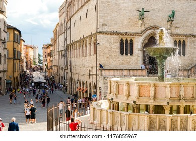Perugia, Umbria, Italy, 08/19/2018: Perugia's Central Square and Its Beautiful Fountain with the Main Street