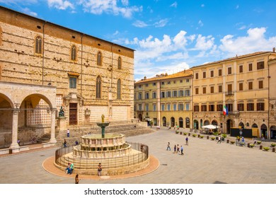 Perugia, Umbria / Italy - 2018/05/28: Panoramic view of the Piazza IV Novembre - Perugia historic quarter main square with XV century St. Lawrence Cathedral and Fontana Maggiore fountain