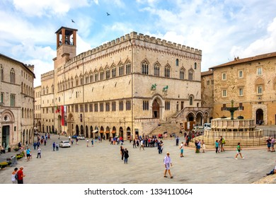 Perugia, Umbria / Italy - 2018/05/28: Panoramic view of the Piazza IV Novembre - Perugia historic quarter main square with medieval Palazzo dei Priori city hall and Fontana Maggiore fountain