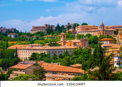 Perugia, Umbria / Italy - 2018/05/28: Panoramic view of the Perugia historic quarter with medieval houses and academic quarter of University of Perugia and other academies