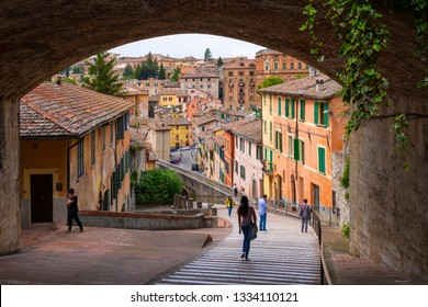 Perugia, Umbria / Italy - 2018/05/28: Panoramic view of the historic aqueduct forming Via dell Acquedotto pedestrian street along the ancient Via Appia street in Perugia historic quarter