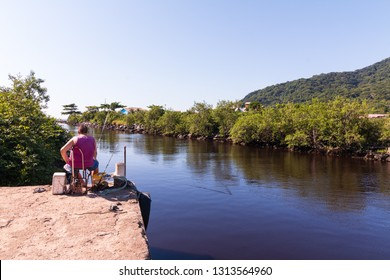Peruibe, SP / Brazil - 02/10/2019: Fishing man in the Peruibe river.