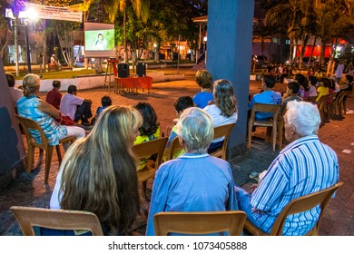 Peruibe, SP, Brazil, April 10, 2009. Audience watching a movie outdoors in St. John the Baptist Square, known as Cathedral Square in the center of Peruibe, SP.