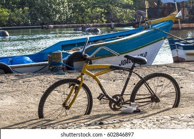 Peruibe, SP, Brazil, May 11, 2009. Bicycle and boats in the fishing port of the mouth of Rio Preto, in Peruibe