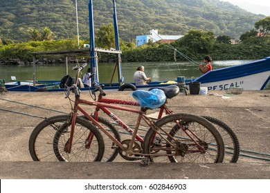 Peruibe, SP, Brazil, May 11, 2009. Bicycles, boats and fishermen in the fishing port of the mouth of Rio Preto, in Peruibe