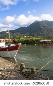 Peruibe, SP, Brazil, May 11, 2009. Boats and fishermen in the fishing port of the mouth of Rio Preto, in Peruibe