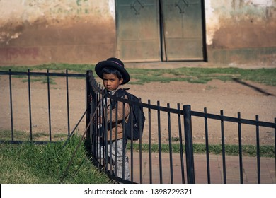 Peruvian boy watching by the side of the road. Carampa, Ayacucho. May 05 2016