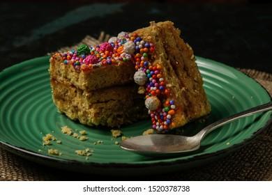 Peruvian classic dessert, turron de Doña pepa with honey and candies