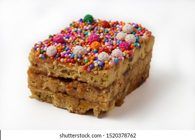 Peruvian classic dessert, turron de Doña pepa with honey and candies, isolated over a white background.