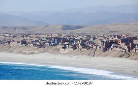 PERUVIAN DESERT 11 22 2010: Coast village in the desert of Peruvian west coast bordering the Pacific Ocean is a long desert strip that stretches
