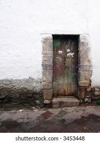 Peruvian doorway on an uphill street in Cusco