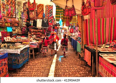 Peruvian family walking in local market