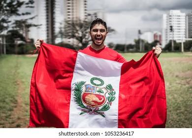 Peruvian fan celebrating during a soccer game