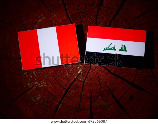 Peruvian flag with Iraqi flag on a tree stump isolated
