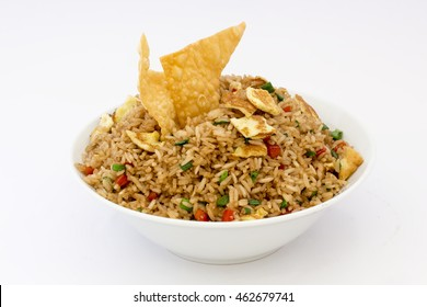 """Peruvian food, """"arroz chaufa"""" fried rice with wantan over white background."""