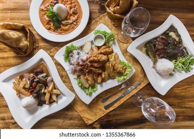 Peruvian food, ceviche, lomo saltado, piqueo on an elegant restaurant table