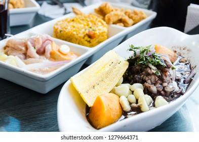 Peruvian food: conchas negras cebiche and in the background triple, cebiche, seafood rice and chicharron of fish