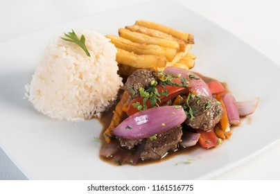 Peruvian food lomo saltado :A salted beef with tomatoes, onion, fried potatoes and rice.