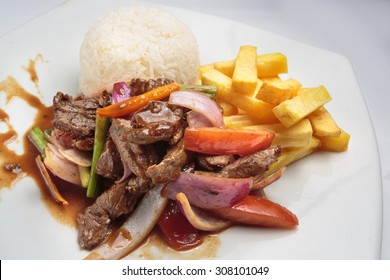 "Peruvian food ""lomo saltado"":A salted beef with tomatoes, onion, fried potatoes and rice."