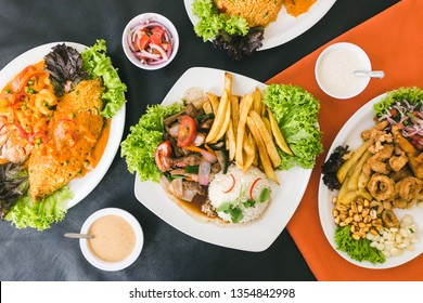 Peruvian food, seafood, french fries and sauces