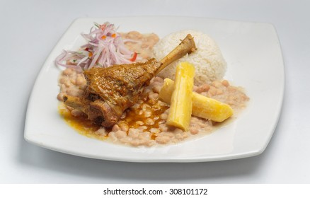 """Peruvian food, """"Seco de cabrito"""" a goat meal served with rice and beans."""