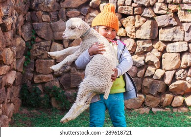 Peruvian girl with a sheep