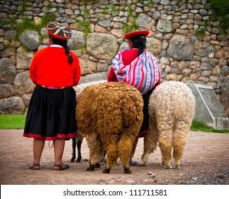 Peruvian Girls and Alpacas at Sacsayhuaman, Cusco Peru