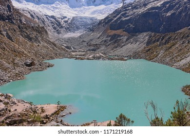 A Peruvian lagoon named Llaca with the glaciers in the background