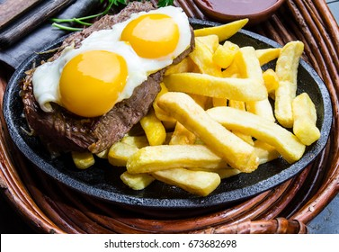 Peruvian Latin American food. Lomo a lo pobre. Beef tenderloin with fried potatoes french fries and eggs