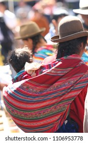 Peruvian Mothers hanging their childs in colorful cloth