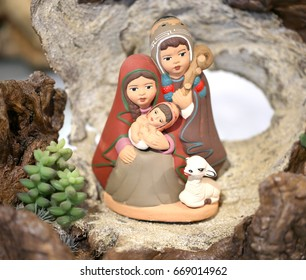 Peruvian nativity scene with the Holy Family and the little baby Jesus made with painted pottery