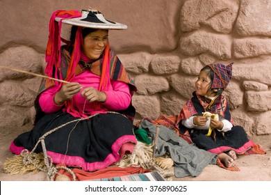 Peruvian people in traditional clothes near Cusco, Peru, July 16, 2009