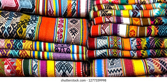 Peruvian traditional colourful native handicraft textile fabric at market in Peru, South Americain. Close up. selective focus