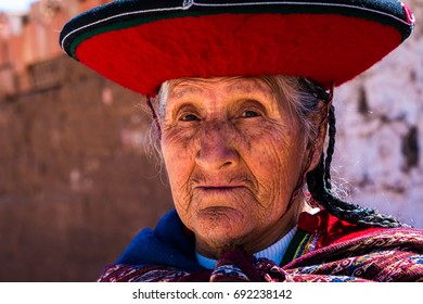 Peruvian traditional old woman (Quechua lady) in the street of Chinchero, Peru